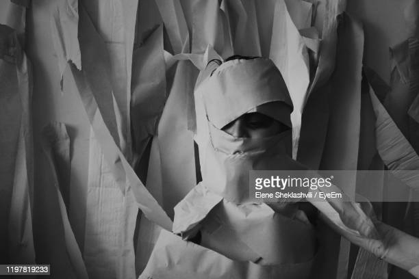 boy wrapped in toilet paper standing at home - wrapped in toilet paper stock pictures, royalty-free photos & images