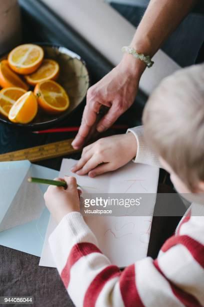 Boy writes a letter to Santa