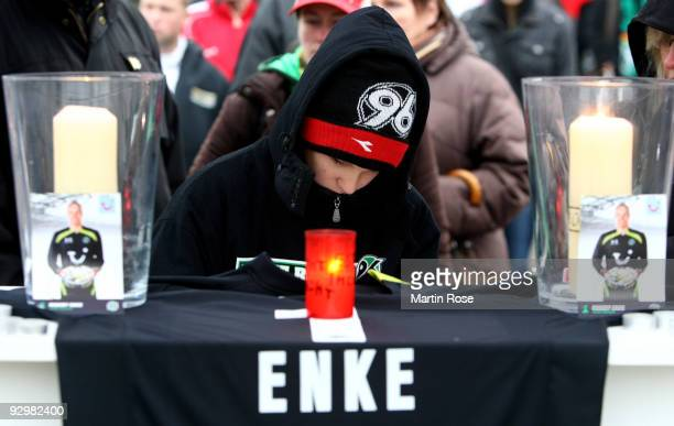 A boy writes in the book of condolence in front of the AWD Arena on November 11 2009 in Hanover Germany Enke goalkeeper for Hannover 96 and the...