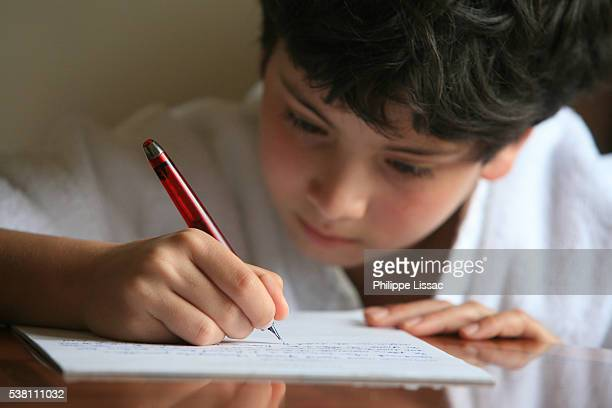 boy writing a letter - the alphabet stock pictures, royalty-free photos & images
