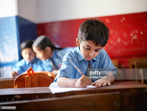 Boy Writing in Class