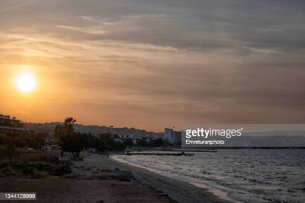 boyalik beach in çeşme at sunset. - emreturanphoto stock pictures, royalty-free photos & images