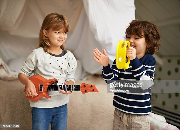 boy-and-girl band - tambourine stock pictures, royalty-free photos & images
