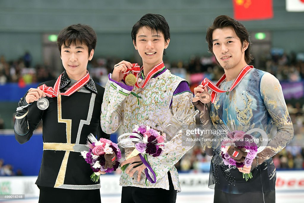 Boyang Jin of China (SILVER), Yuzuru Hanyu of Japan (Gold) and Takahito Mura of Japan (Bronze) pose woth thier medals duringthe day two of the NHK Trophy ISU Grand Prix of Figure Skating 2015 at the Big Hat on November 28, 2015 in Nagano, Japan.