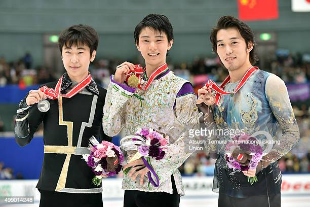 Boyang Jin of China Yuzuru Hanyu of Japan and Takahito Mura of Japan pose woth thier medals duringthe day two of the NHK Trophy ISU Grand Prix of...