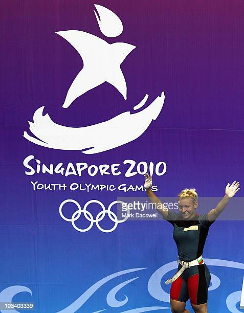Boyanka Kostova of Bulgaria celebrates winning the gold medal in the Womens 53kg Weightlifting final on day two of the Youth Olympics at Toa Payoh...