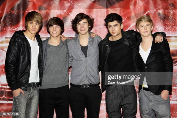 Boyband One Direction pose for a photocall to promote the XFactor final held at The Connaught Hotel on December 9 2010 in London England