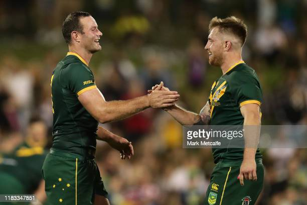 Boyd Cordner and Cameron Munster of Australia celebrate victory in the International Rugby League Test Match between the Australian Kangaroos and the...