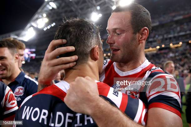 Boyd Cordner and Cooper Cronk of the Roosters embrace after winning the 2018 NRL Grand Final match between the Melbourne Storm and the Sydney...