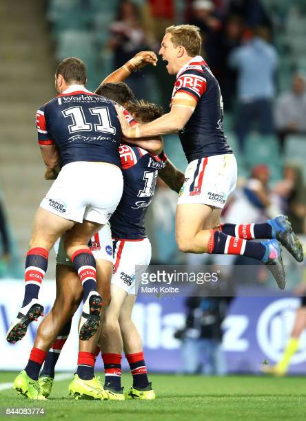 Boyd Cordner Connor Watson and Mitchell Aubusson of the Roosters celebrate with Latrell Mitchell after he scored a try during the NRL Qualifying...