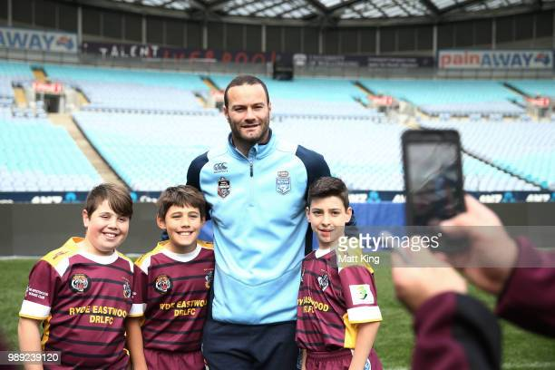 Boyd Cordner meets young participents during the New South Wales Blues State of Origin Team Announcement at ANZ Stadium on July 2 2018 in Sydney...