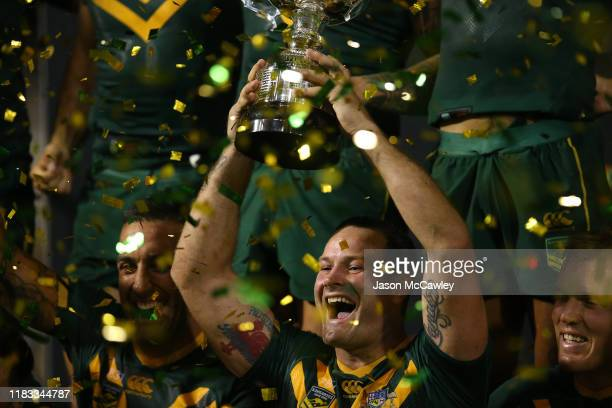 Boyd Cordner of Australia celebrates with the trophy after victory during the International Rugby League Test Match between the Australian Kangaroos...