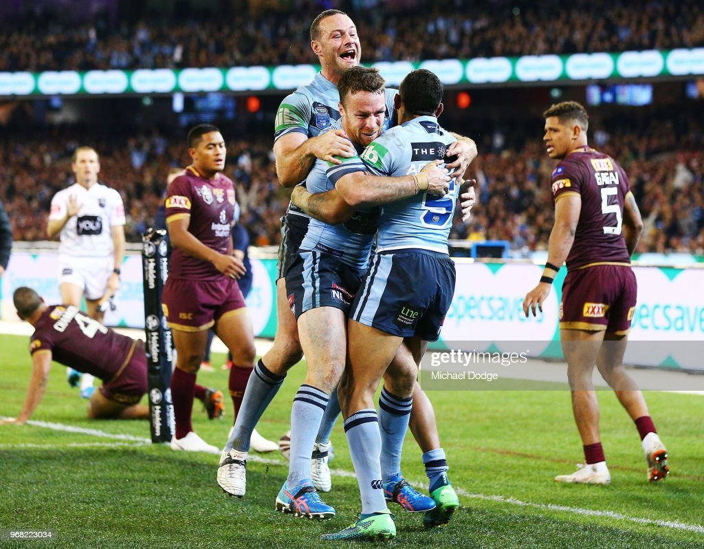 Boyd Cordner of the Blues (L) and James Maloney celebrate after Josh Addo-Carr (R) of the Blues scores a try during game one of the State Of Origin series between the Queensland Maroons and the New South Wales Blues at the Melbourne Cricket Ground on June 6, 2018 in Melbourne, Australia.