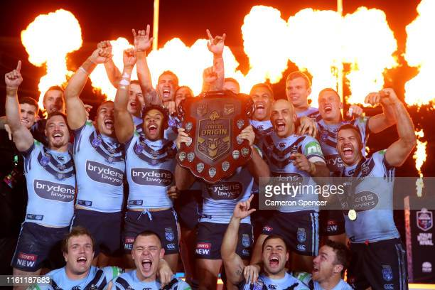 Boyd Cordner of the Blues and team mates celebrate with the State of Origin trophy after winning the series and winning game three of the 2019 State...