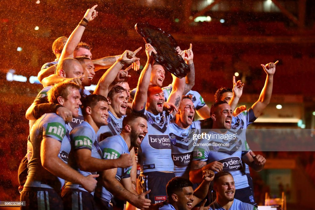 Boyd Cordner of the Blues and team mates celebrate with the trophy after winning the series following game three of the State of Origin series between the Queensland Maroons and the New South Wales Blues at Suncorp Stadium on July 11, 2018 in Brisbane, Australia.