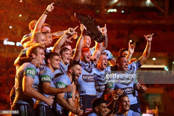 Boyd Cordner of the Blues and team mates celebrate with the trophy after winning the series following game three of the State of Origin series...
