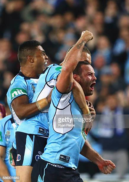 Boyd Cordner of the Blues celebrates after scoring a try during game one of the State Of Origin series between the New South Wales Blues and the...