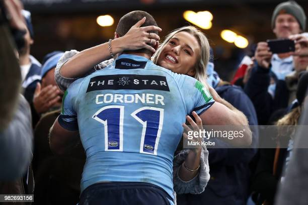 Boyd Cordner of the Blues celebrates victory with his partner Jemma Barge after game two of the State of Origin series between the New South Wales...