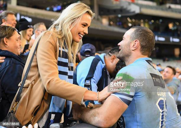 Boyd Cordner of the Blues celebrates with family and friends in the crowd after winning game one of the State Of Origin series between the Queensland...