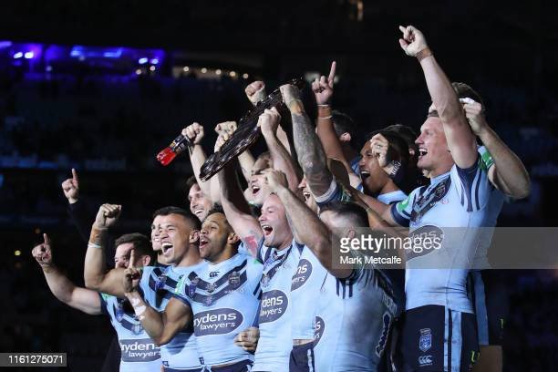 Boyd Cordner of the Blues celebrates with the trophy after winning the series following game three of the State of Origin series betweenduring game...