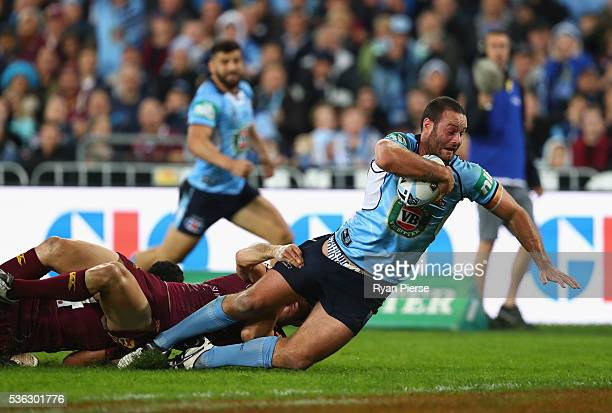 Boyd Cordner of the Blues scores a try during game one of the State Of Origin series between the New South Wales Blues and the Queensland Maroons at...