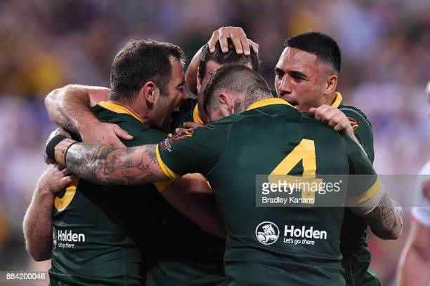 Boyd Cordner of the Kangaroos celebrates scoring a try during the 2017 Rugby League World Cup Final between the Australian Kangaroos and England at...