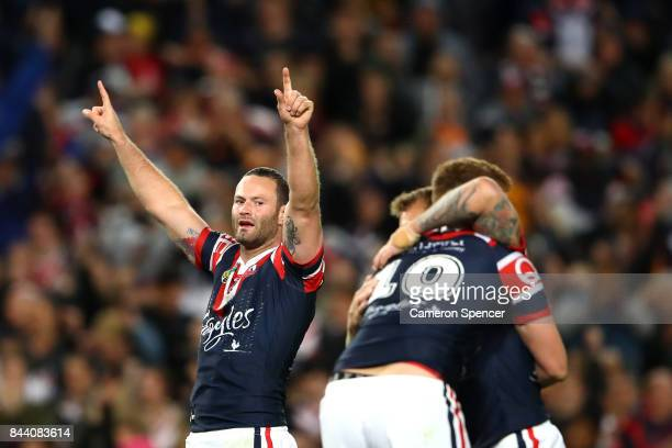 Boyd Cordner of the Roosters and team mates celebrate winning the NRL Qualifying Final match between the Sydney Roosters and the Brisbane Broncos at...