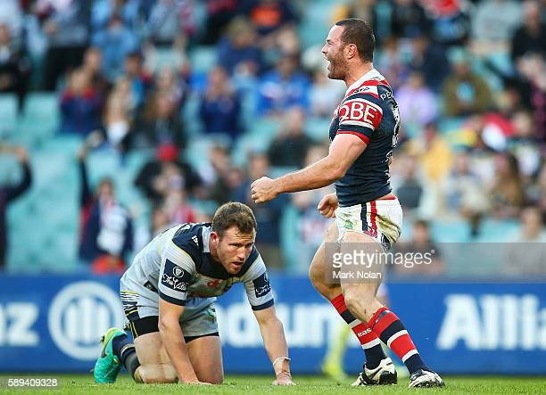 Boyd Cordner of the Roosters celebrates scoring a try during the round 23 NRL match between the Sydney Roosters and the North Queensland Cowboys at...