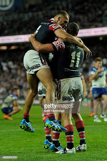 Boyd Cordner of the Roosters celebrates scoring a try with team mates during the First NRL Semi Final match between the Sydney Roosters and the...