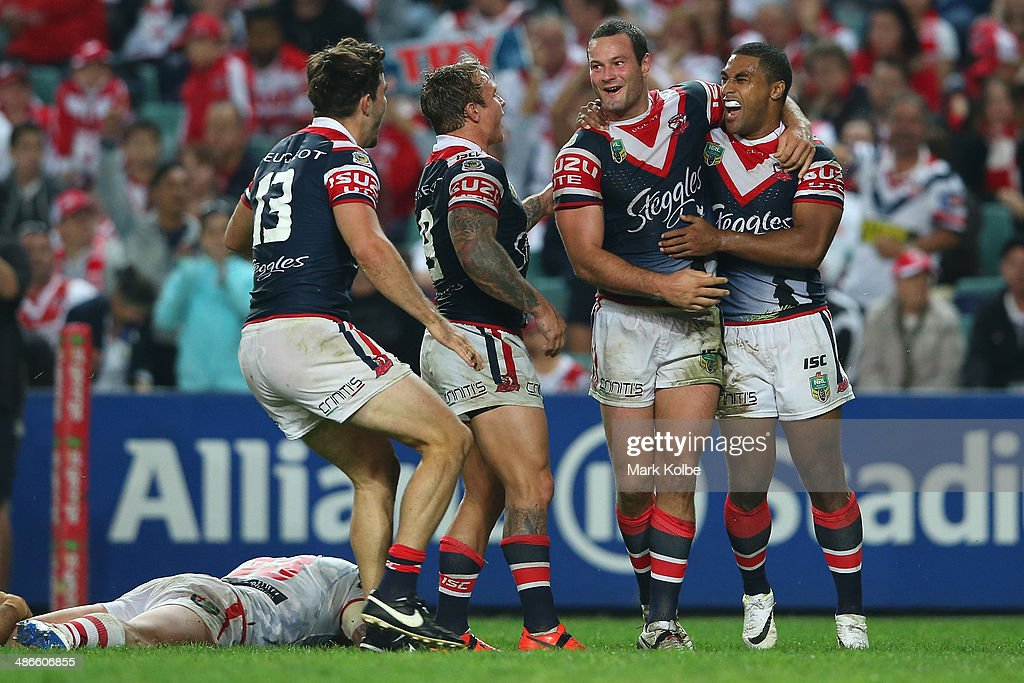 Boyd Cordner of the Roosters celebrates with Aidan Guerra, Jake Friend and Michael Jennings of the Roosters after scoring a try during the round 8 NRL match between the St George Illawarra Dragons and the Sydney Roosters at Allianz Stadium on April 25, 2014 in Sydney, Australia.
