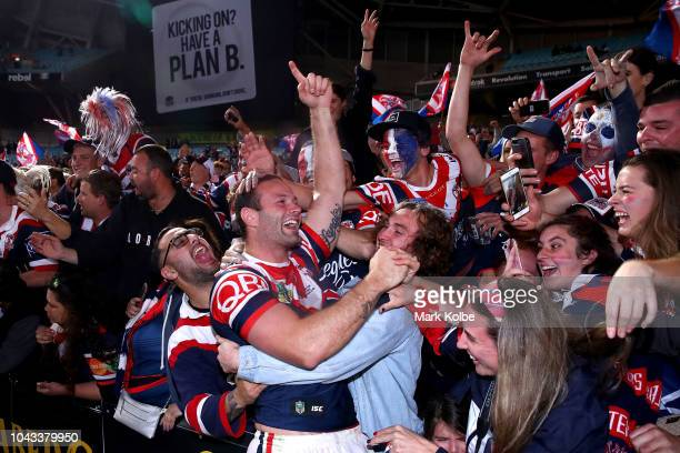 Boyd Cordner of the Roosters celebrates with fans after winning the 2018 NRL Grand Final match between the Melbourne Storm and the Sydney Roosters at...