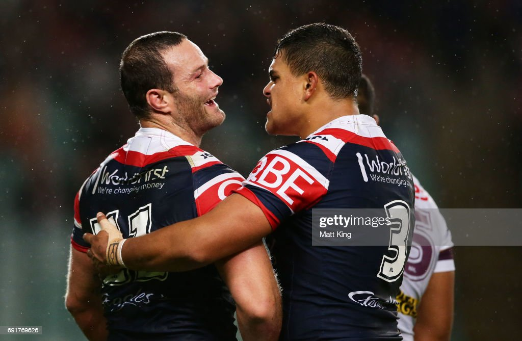 Boyd Cordner of the Roosters (L) celebrates with Latrell Mitchell of the Roosters (R) after scoring a try during the round 13 NRL match between the Sydney Roosters and the Brisbane Broncos at Allianz Stadium on June 3, 2017 in Sydney, Australia.