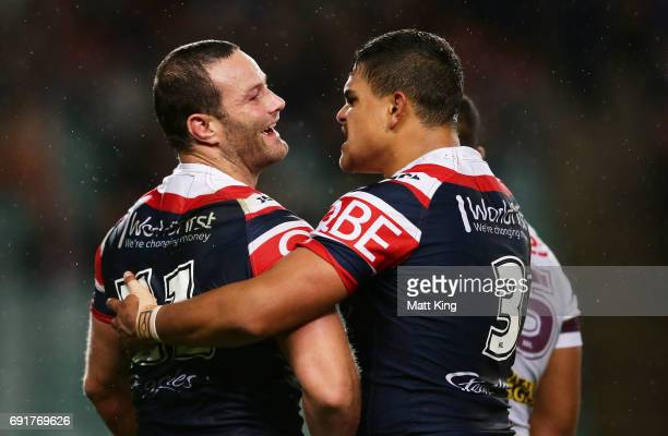 Boyd Cordner of the Roosters celebrates with Latrell Mitchell of the Roosters after scoring a try during the round 13 NRL match between the Sydney...