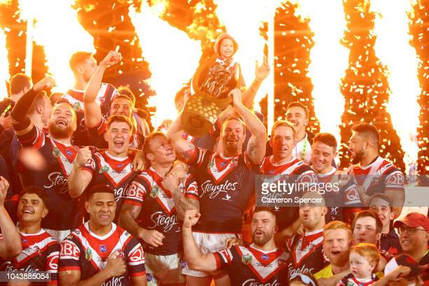 Boyd Cordner of the Roosters celebrates with the ProvenSummonsÊTrophy and team mates after winning the 2018 NRL Grand Final match between the...