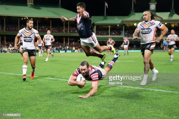 Boyd Cordner of the Roosters dives in to score a try as Latrell Mitchell of the Roosters jumps over the top during the round eight NRL match between...