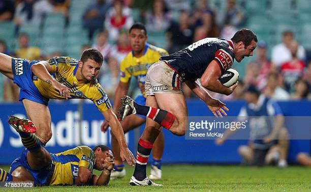 Boyd Cordner of the Roosters escapes the defence of Luke Kelly and Will Hopoate during the round two NRL match between the Sydney Roosters and the...