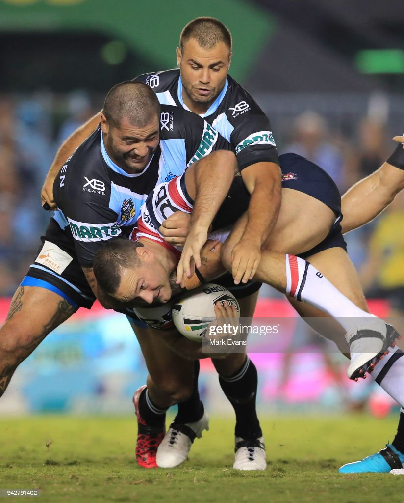 Boyd Cordner of the Roosters is tackled by Andrew Fifita and Wade Graham of the Sharks during the round five NRL match between the Cronulla Sharks and the Sydney Roosters at Southern Cross Group Stadium on April 6, 2018 in Sydney, Australia.