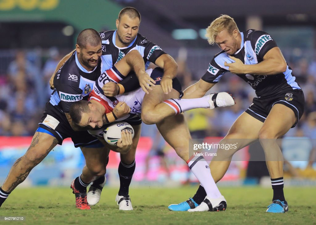 Boyd Cordner of the Roosters is tackled by Andrew Fifita, Wade Graham and Matt Prior of the Sharks during the round five NRL match between the Cronulla Sharks and the Sydney Roosters at Southern Cross Group Stadium on April 6, 2018 in Sydney, Australia.