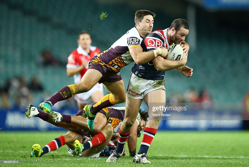 Boyd Cordner of the Roosters is tackled by Ben Hunt of the Broncos during the round 21 NRL match between the Sydney Roosters and the Brisbane Broncos at Allianz Stadium on July 28, 2016 in Sydney, Australia.