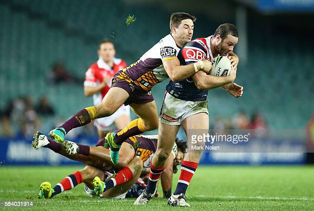 Boyd Cordner of the Roosters is tackled by Ben Hunt of the Broncos during the round 21 NRL match between the Sydney Roosters and the Brisbane Broncos...