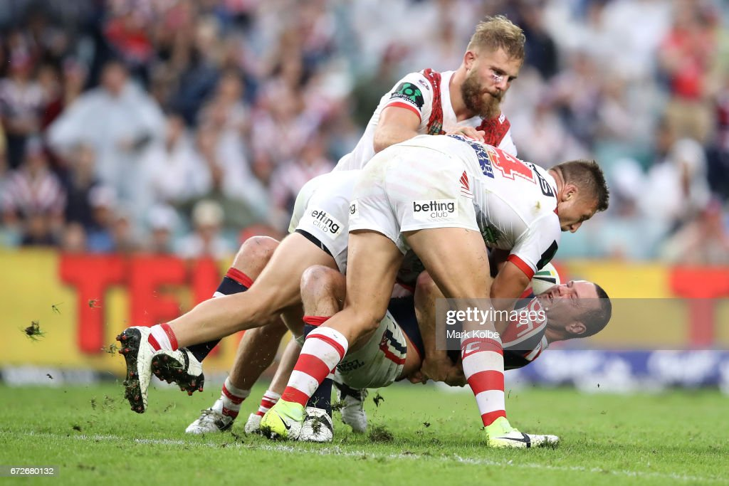 Boyd Cordner of the Roosters is tackled by Jack de Belin, Cameron McInnes and Tariq Sims of the Dragons during the round eight NRL match between the Sydney Roosters and the St George Illawarra Dragons at Allianz Stadium on April 25, 2017 in Sydney, Australia.
