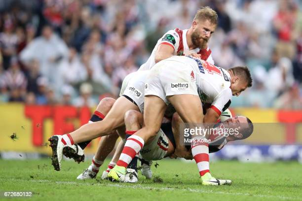Boyd Cordner of the Roosters is tackled by Jack de Belin Cameron McInnes and Tariq Sims of the Dragons during the round eight NRL match between the...