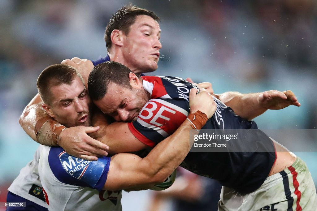 Boyd Cordner of the Roosters is tackled by Kieran Foran and Joshua Jackson of the Bulldogs during the round seven NRL match between the Canterbury Bulldogs and the Sydney Roosters at ANZ Stadium on April 19, 2018 in Sydney, Australia.