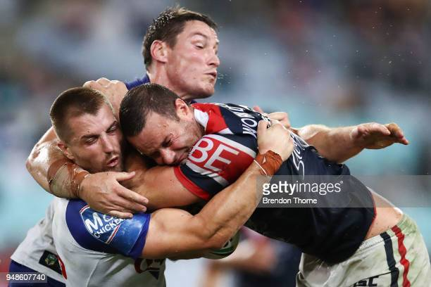 Boyd Cordner of the Roosters is tackled by Kieran Foran and Joshua Jackson of the Bulldogs during the round seven NRL match between the Canterbury...