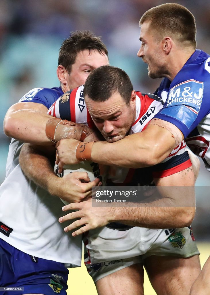 Boyd Cordner of the Roosters is tackled by the Bulldogs defence during the round seven NRL match between the Canterbury Bulldogs and the Sydney Roosters at ANZ Stadium on April 19, 2018 in Sydney, Australia.