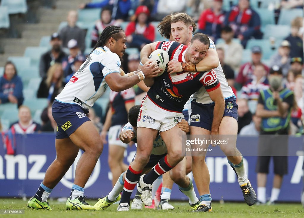 Boyd Cordner of the Roosters is tackled by Titans defence during the round 26 NRL match between the Sydney Roosters and the Gold Coast Titans at Allianz Stadium on September 2, 2017 in Sydney, Australia.