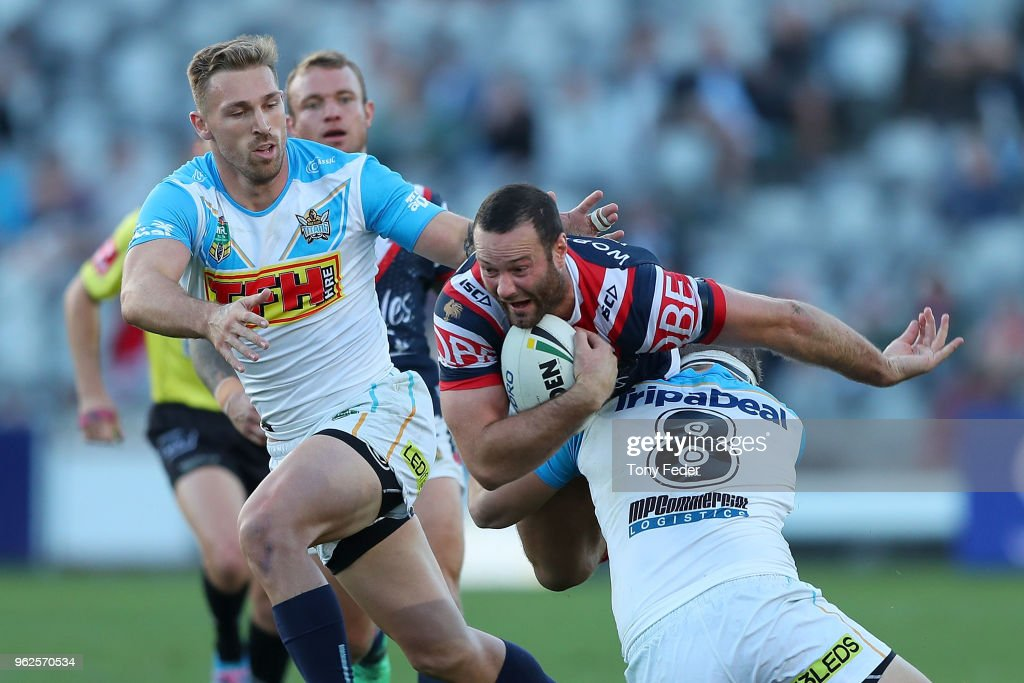 Boyd Cordner of the Roosters is tackled during the round 12 NRL match between the Sydney Roosters and the Gold Coast Titans at Central Coast Stadium on May 26, 2018 in Gosford, Australia.
