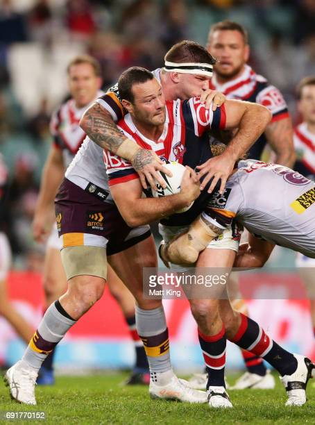 Boyd Cordner of the Roosters is tackled during the round 13 NRL match between the Sydney Roosters and the Brisbane Broncos at Allianz Stadium on June...