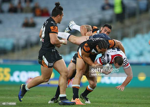 Boyd Cordner of the Roosters is tackled during the round 20 NRL match between the Wests Tigers and the Sydney Roosters at ANZ Stadium on July 24 2015...