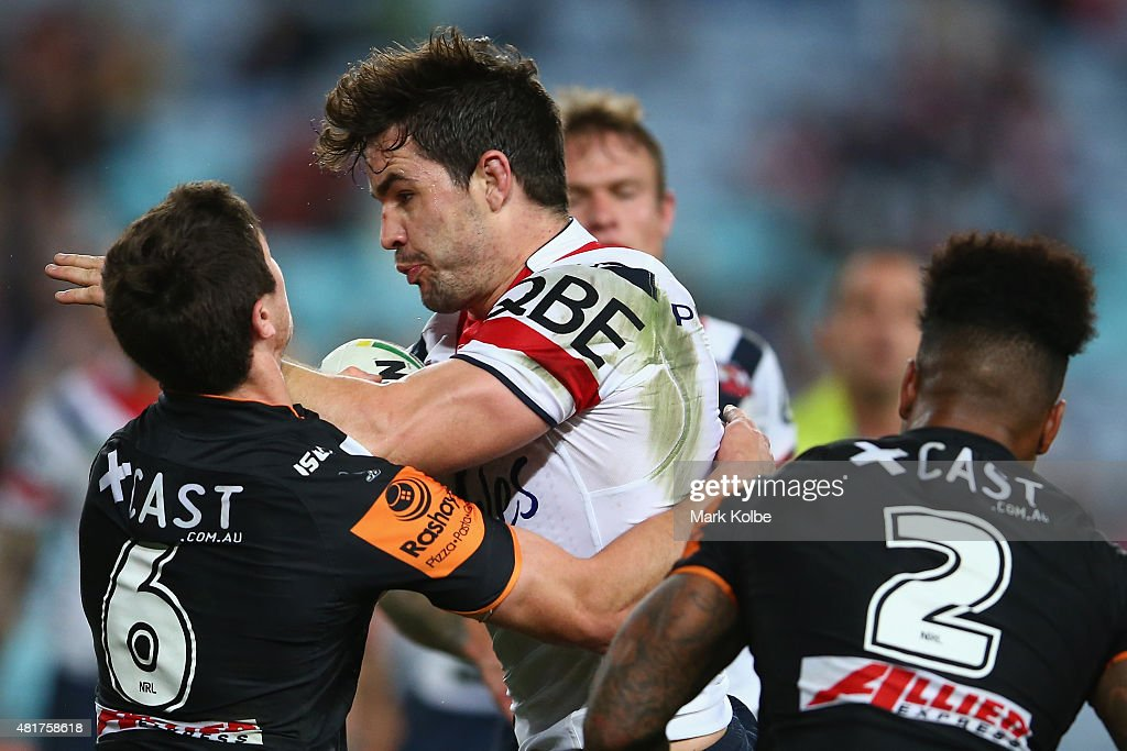Boyd Cordner of the Roosters is tackled during the round 20 NRL match between the Wests Tigers and the Sydney Roosters at ANZ Stadium on July 24, 2015 in Sydney, Australia.